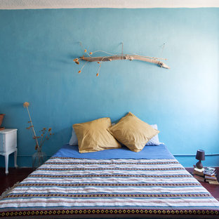Inspiration for a mediterranean master terra-cotta floor and red floor bedroom remodel in Other with blue walls