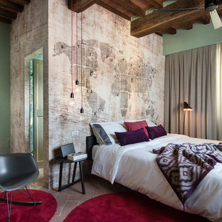 Design ideas for a large contemporary master bedroom in Florence with multi-coloured walls and terra-cotta floors.