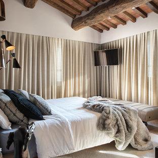Immagine di una grande camera matrimoniale contemporanea con pareti bianche e pavimento in mattoni