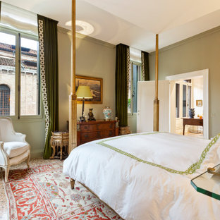 Photo of a mediterranean bedroom in Venice with green walls and brown floor.
