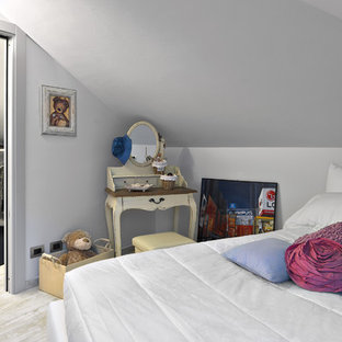 Large modern loft-style bedroom in Turin with white walls and porcelain floors.