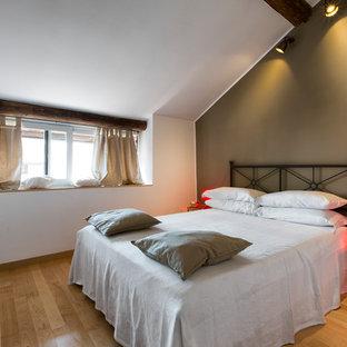 Camera da letto con parquet chiaro - Foto e Idee per Arredare
