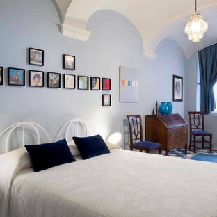 Bedroom - eclectic master carpeted and blue floor bedroom idea in Milan with blue walls