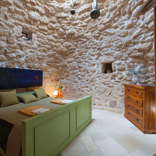 Example of a small eclectic master limestone floor bedroom design in Bari with beige walls