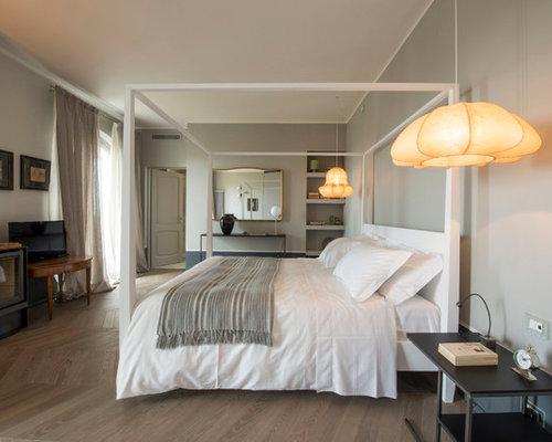 Camera da letto contemporanea con stufa a legna - Foto e Idee per ...