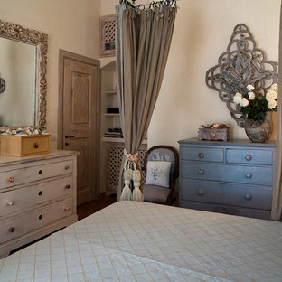 Example of a tuscan master terra-cotta floor and red floor bedroom design in Other with pink walls