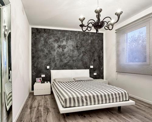 Camera da letto contemporanea con pareti nere - Foto e Idee per ...