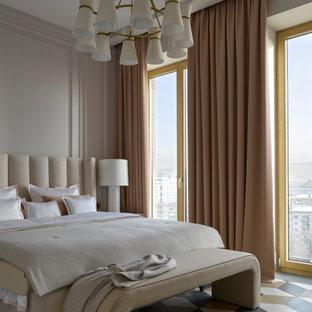 Immagine di una camera matrimoniale design di medie dimensioni con pareti beige, pavimento in gres porcellanato, pavimento multicolore e boiserie