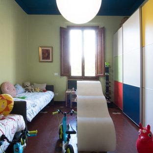 Aménagement d'une chambre d'enfant de 1 à 3 ans contemporaine de taille moyenne avec un mur vert et un sol en carreau de terre cuite.