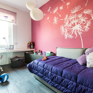 Photo of a medium sized contemporary teen's room for girls in Milan with pink walls and dark hardwood flooring.
