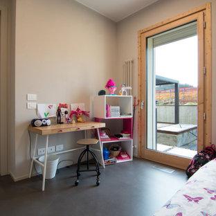 Idéer för ett litet industriellt flickrum kombinerat med sovrum och för 4-10-åringar, med grå väggar, betonggolv och grått golv