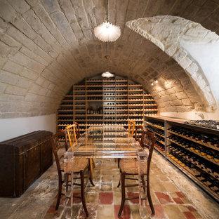 Idéer för att renovera en medelhavsstil vinkällare, med vinhyllor och flerfärgat golv