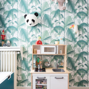 Photo of a medium sized scandinavian children's room for boys in London with white walls, medium hardwood flooring and brown floors.