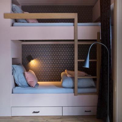 Kids' bedroom - mid-sized contemporary girl light wood floor and brown floor kids' bedroom idea in Lyon with pink walls