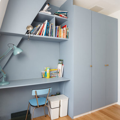 Inspiration for a mid-sized contemporary boy beige floor and medium tone wood floor kids' room remodel in London with blue walls