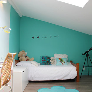 Example of a small cottage chic girl laminate floor kids' room design in Bordeaux with blue walls