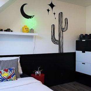 Idées déco pour une chambre d'enfant contemporaine avec un mur noir.