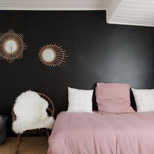 Réalisation d'une chambre d'enfant nordique avec un mur noir, moquette et un sol beige.