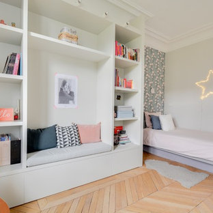 Kids' room - mid-sized transitional girl light wood floor kids' room idea in Paris with gray walls