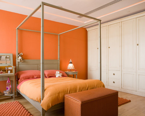 chambre d 39 enfant avec un mur orange photos et id es d co de chambres d 39 enfant. Black Bedroom Furniture Sets. Home Design Ideas