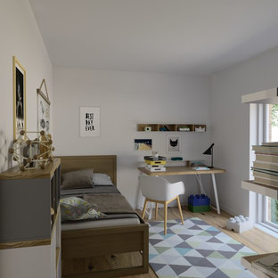 Design ideas for a small scandinavian teen's room for boys in Clermont-Ferrand with white walls and laminate floors.