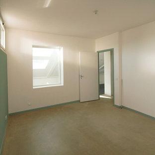 Idéer för stora funkis könsneutrala tonårsrum kombinerat med sovrum, med gröna väggar, betonggolv och grått golv
