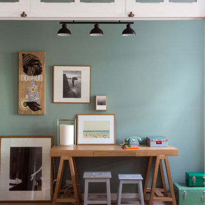Kids' room - mid-sized contemporary gender-neutral medium tone wood floor and brown floor kids' room idea in Paris with green walls