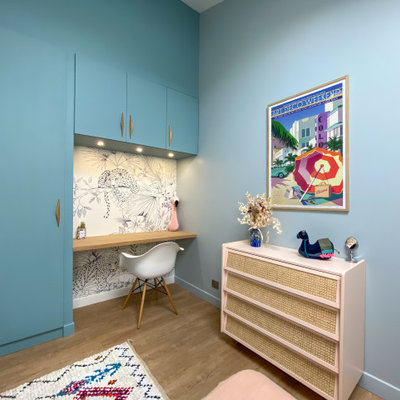 Example of a mid-sized trendy girl medium tone wood floor and beige floor kids' room design in Bordeaux with blue walls