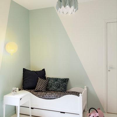 Trendy gender-neutral white floor kids' room photo in Paris with blue walls