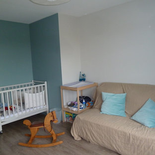 Photo of a large nautical gender neutral nursery in Bordeaux with blue walls, vinyl flooring and grey floors.