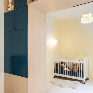 Inspiration for a contemporary gender-neutral nursery in Paris with yellow walls and white floor.