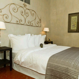 Inspiration for a small country master bedroom in Marseille with green walls, terra-cotta floors and no fireplace.