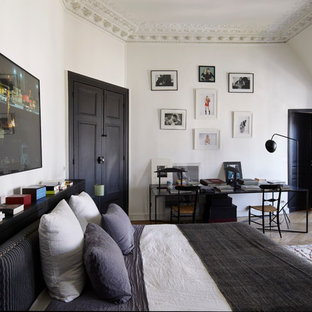 Inspiration for a contemporary master bedroom in Paris with white walls, medium hardwood flooring and no fireplace.