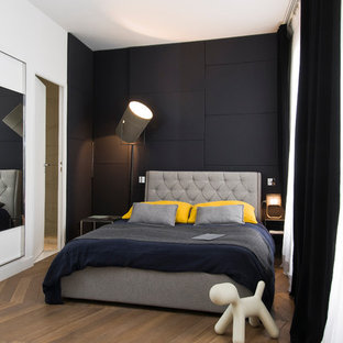 Mid-sized contemporary master bedroom in Paris with white walls and medium hardwood floors.