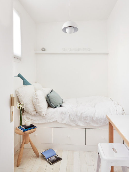 Small Danish Master Light Wood Floor Bedroom Photo In Paris With White Walls