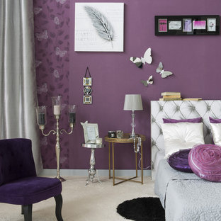 Example of a mid-sized cottage chic master carpeted bedroom design in Lille with purple walls