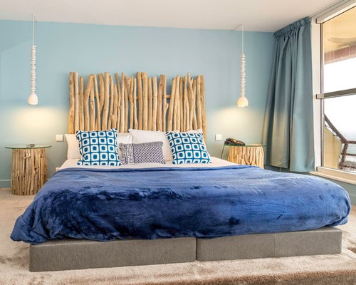 chambre bord de mer avec un mur bleu photos et id es d co de chambres. Black Bedroom Furniture Sets. Home Design Ideas