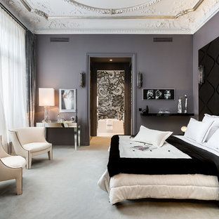 This is an example of a large traditional master bedroom in Paris with grey walls, carpet and no fireplace.