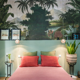 Photo of a tropical bedroom in Paris.