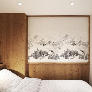 Cette photo montre une petit chambre montagne avec du papier peint.