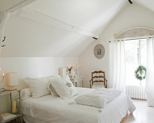 Example of a cottage chic light wood floor bedroom design in Paris with  white walls. French Bedroom   Houzz