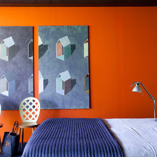 Contemporary bedroom in Paris with orange walls.