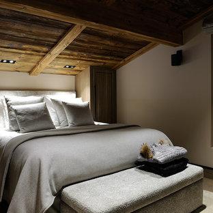 Bedroom - large rustic master light wood floor and beige floor bedroom idea in Other with beige walls