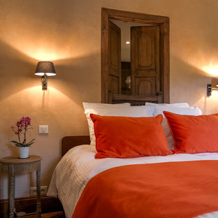 Example of a large transitional master terra-cotta floor and red floor bedroom design in Toulouse with beige walls