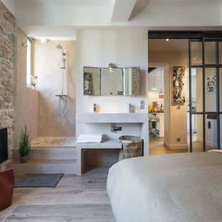Inspiration for a mid-sized mediterranean master light wood floor bedroom remodel in Nice