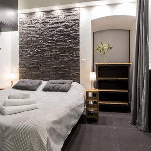 Ispirazione per una camera matrimoniale minimal di medie dimensioni con pareti bianche e pavimento con piastrelle in ceramica