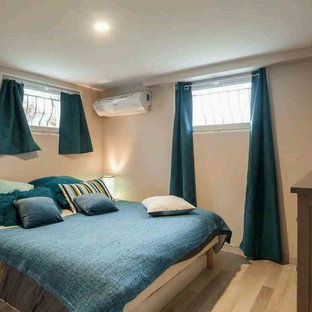Medium Sized Contemporary Guest Bedroom In Lyon With Beige Walls Laminate Floors No Fireplace