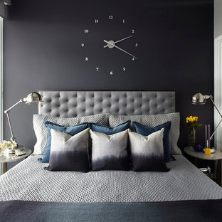 Example of a transitional bedroom design in Toronto with black walls