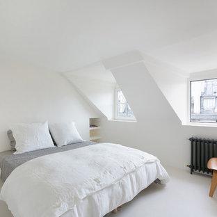 Idées déco pour une chambre moderne avec un mur blanc, aucune cheminée et un sol blanc.
