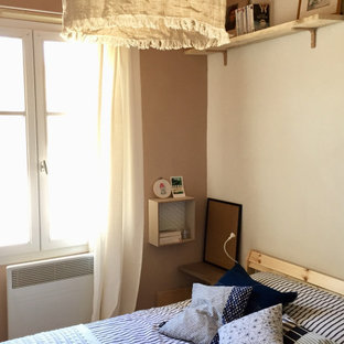Example of a small beach style master ceramic tile, beige floor and shiplap ceiling bedroom design in Angers with beige walls and no fireplace